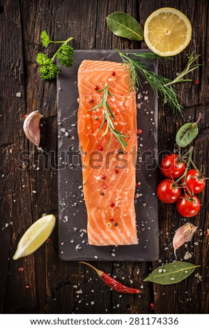 Delicious salmon steak on wooden table, close-up - stock photo