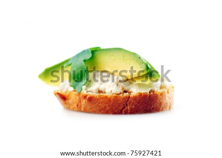 delicious sandwich of toasted bread, avocado and spinach