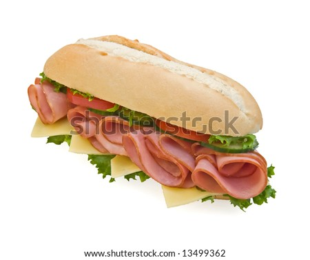 Delicious sandwich with ham, tomatoes, cucumbers and swiss cheese - stock photo