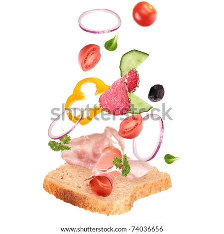 Delicious sandwich with ingredients in the air - stock photo