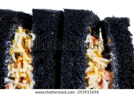 Delicious sandwiches black bread on white background. - stock photo