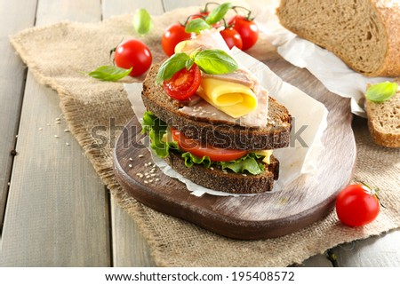 Delicious sandwiches with meet on table close-up - stock photo