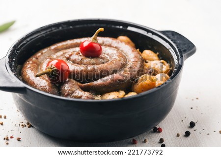 Delicious sausage with beans - stock photo