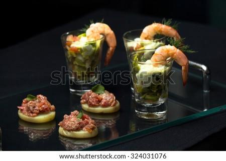 Delicious Shrimp Cocktail, Shrimp, avocado, fresh tomatoes, onions and cream cheese. - stock photo