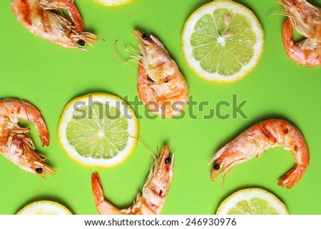 Delicious shrimps on a green background - stock photo