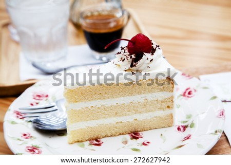 Delicious slice of cake with strawberry and topping on a plate  - stock photo