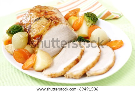 Delicious sliced roast pork with vegetables - stock photo