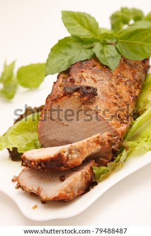 Delicious smoked pork with basil - stock photo