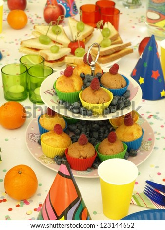 Delicious snacks for perfect children's party, laid table - stock photo