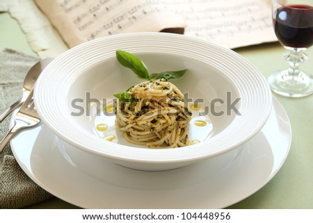 Delicious spaghetti with pesto with red wine ready to serve. - stock photo