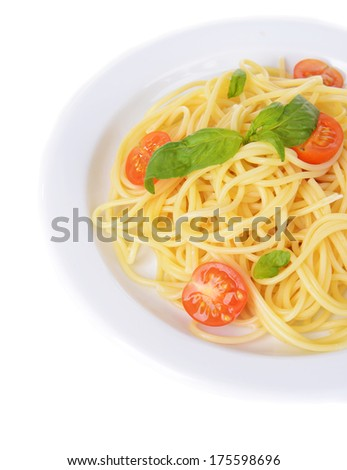 Delicious spaghetti with tomatoes on plate isolated on white