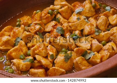 Delicious Spanish chicken casserole on a terracotta plate - stock photo