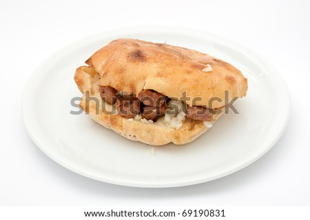 Delicious specialty made on grill from small dumplings of minced meat with onion - stock photo