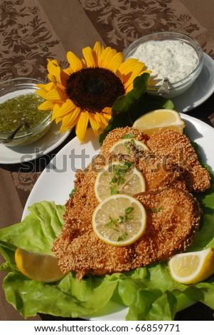 Delicious spiced catfish escalope in sesame