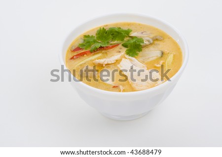 delicious spicy coconut cream soup with chicken - stock photo