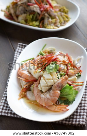 Delicious spicy seafood thai food. Thai spicy and sour seafood salad call YUM or YAM - stock photo