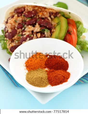 Delicious spicy tortilla with hot spices in a bowl. - stock photo
