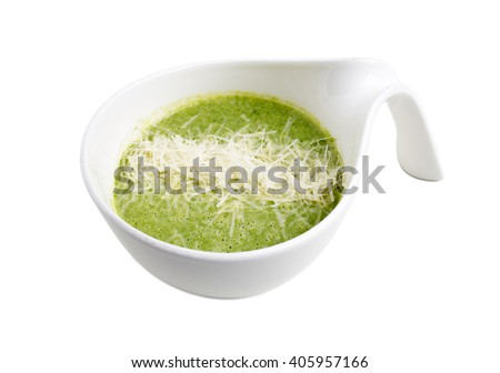 Delicious spinach cream soup with parmesan. Isolated on a white background. - stock photo