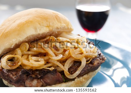 Delicious steak burger with fried onions ready to serve. - stock photo
