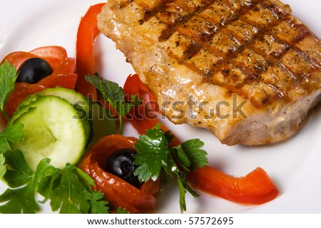Delicious steak with vegetables close up photo
