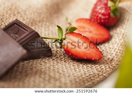 delicious strawberries and chocolate chips - stock photo