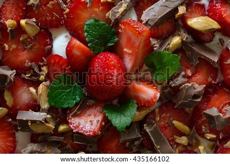 Delicious strawberries as a topping on a cake with chocolate. - stock photo