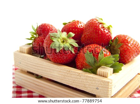 Delicious strawberries in an open crate isolated over white - stock photo