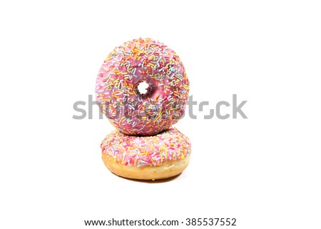 Delicious strawberry donuts on white background - stock photo