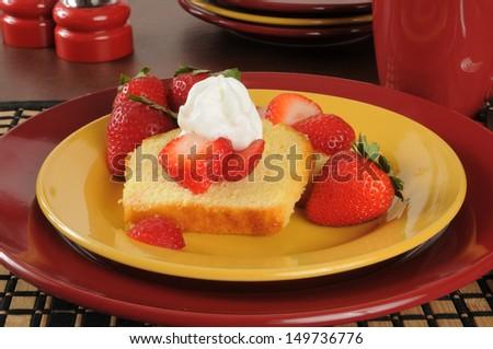 Delicious strawberry shortcake on colorful plates - stock photo