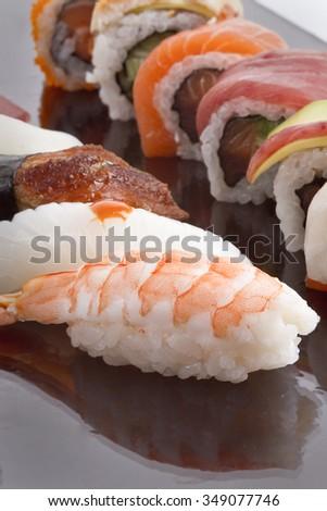 delicious sushi bar on black background. - stock photo