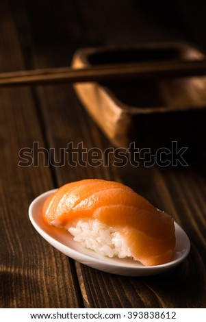 Delicious sushi nigiri of salmon on a dark wooden table. Copy space. - stock photo