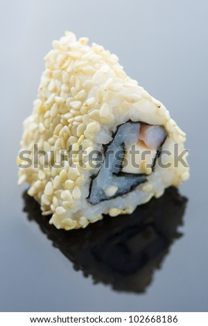Delicious sushi with salmon, avocado sesame and shrimp