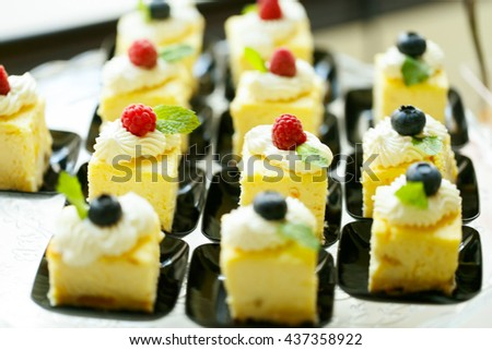 Delicious sweet cakes and pastry at wedding  dessert table reception closeup - stock photo
