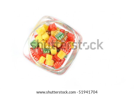 delicious sweet candies in sugar in a glass jar. white background. copy-space - stock photo