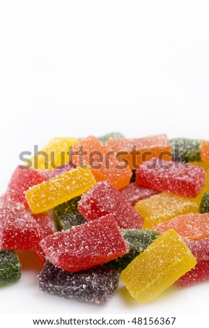 delicious sweet candies in sugar. white background - stock photo