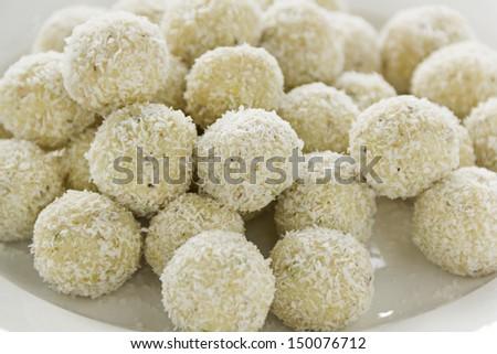Delicious sweet Indian coconut cardamon burfi treats ready to serve. - stock photo