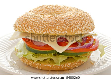 Delicious swiss cheese and veggie sandwich on a bagel with a cilantro spread. - stock photo