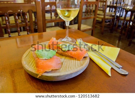 delicious tapas, spanish food cousine culture, served in taberna with glass of wine - stock photo