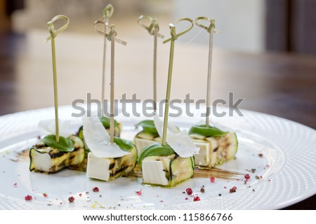 delicious tapas with or finger food on sticks - stock photo