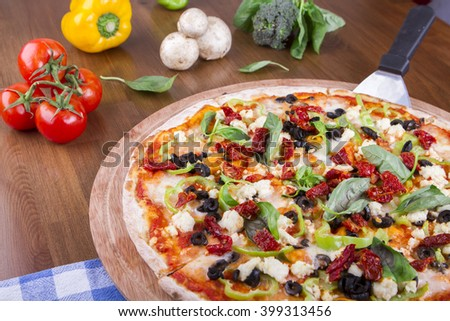 Delicious tasty pizza with vegetables on wooden table with square texture table
