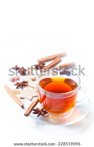 Delicious tea with spices in a glass cup isolated on white - stock photo