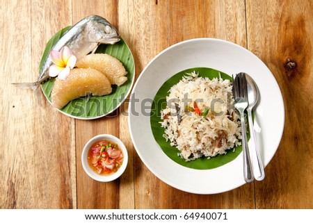 delicious thai food.Grapefruit fried rice with tuna fish on banana leaf and sauce fish ,Thai food. - stock photo