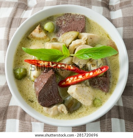 Delicious Thai Spicy Green Curry with Green Eggplant, Chicken and Coconut Milk, One of The Most Famous Curry Recipes in The World. - stock photo