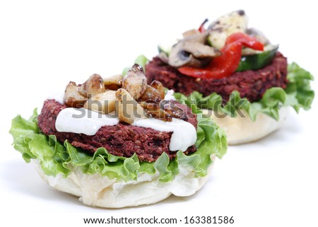 Delicious topless veggie burgers with fixings. - stock photo
