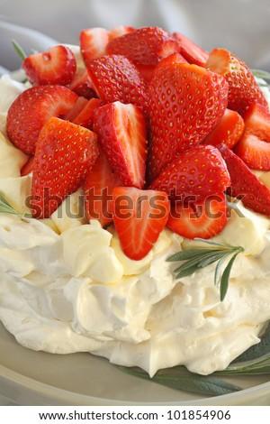 Delicious traditional Australian strawberry pavlova made from meringue and cream. - stock photo