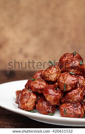 Delicious turkey meatballs in a rich tomato sauce. Extreme shallow depth of field with selective focus on center of image.