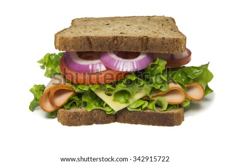 Delicious turkey sandwich  with turkey, swiss cheese, lettuce, tomato and onions - stock photo