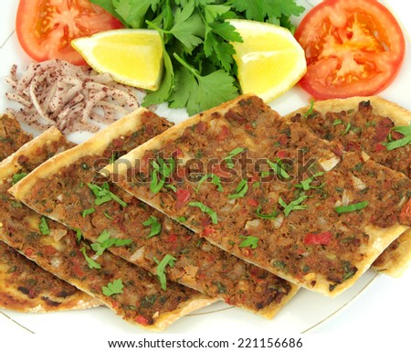 Delicious Turkish Pizza. ( Lahmacun or Etli ekmek ) - stock photo