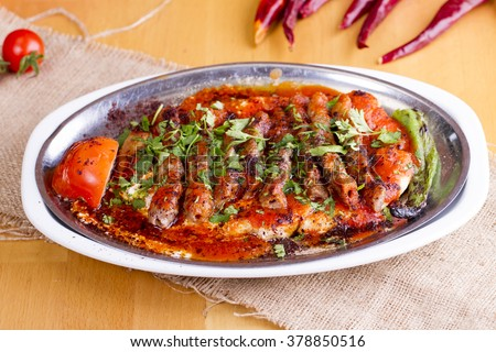 Delicious Turkish Traditional Manisa Kebap, Tire Kofte serving on metal plate - stock photo