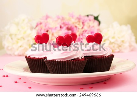 Delicious Valentine Day cupcakes on pink background - stock photo